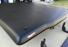 Nissan Titan hard bed cover, aluminum step rails and tow assembly in Fort Hood, Texas