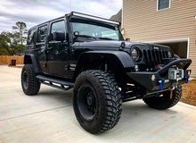 Lifted Jeep Wrangler Unlimited Sport 4X4 in Camp Lejeune, North Carolina