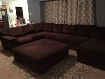 oversized brown sectional sofa in Baytown, Texas