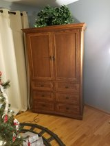Oak Armoire on wheels in St. Charles, Illinois