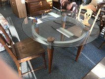 Glass top dining table in Oswego, Illinois