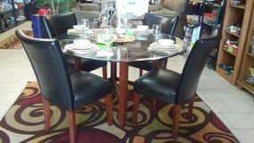 glasstop dining table w/4 chairs in Warner Robins, Georgia