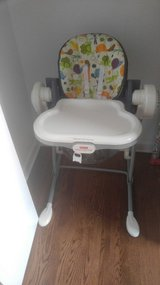 High chair by Fisher Price. Converts to baby swing in Plainfield, Illinois