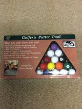 Golfers putter pool game in St. Charles, Illinois