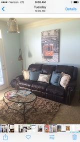 Dark brown leather dual recliner leather couch in Yorkville, Illinois