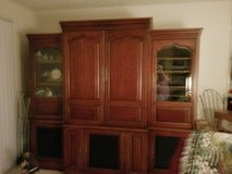 Cherry wood entertainment center in Conroe, Texas