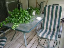 Patio table with 2 rocking chairs in Conroe, Texas