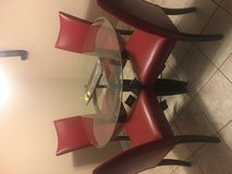 Brand new Ashleys furniture red n glass and chery legs table bought it for $700 dont like it any... in Fort Leonard Wood, Missouri
