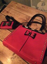 Red purse and handbag in Lakenheath, UK