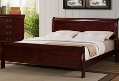 New king cherry sleigh bed,still in boxes in Cherry Point, North Carolina