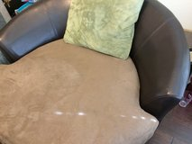 Rotating chair - brown leather in Kingwood, Texas