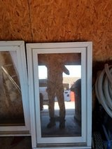 Windows   25 1/2 W X 48 H roll out windows with screens. Used -  2 this size in Camp Lejeune, North Carolina