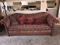 Red and Gold Love seat and big couch with lots of pillows in Kirtland AFB, New Mexico