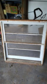 1 small vintage window with frame intact in Kingwood, Texas