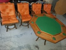 Vintage rattan bamboo chairs and poker table in St. Charles, Illinois