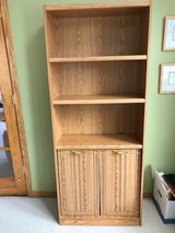 Oak finish book case in Naperville, Illinois