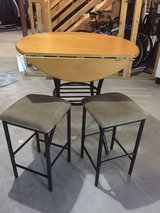 Bar height table and stools in Westmont, Illinois