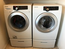 Samsung washer and dryer with pedestals in Naperville, Illinois