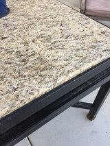 Rod iron granite patio table in 29 Palms, California