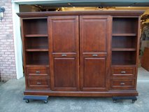 All wooden entertainment center. in Fort Campbell, Kentucky