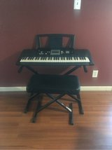 Yamaha keyboard with stand and bench in Kingwood, Texas
