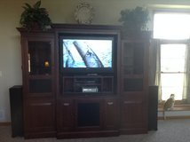 Large cherry entertainment center in Oswego, Illinois