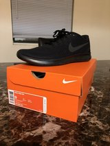 Size 9 Nike running shoes in Fort Drum, New York