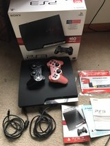 PS3 slim 1 TB with box in Plainfield, Illinois