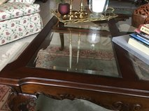 Coffee table- carved wood, 4 glass squares inset. Excellent condition in Ramstein, Germany