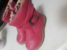 Girls pink boots in Camp Pendleton, California