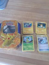 pokemon cards and codes plus tin in Fort Irwin, California