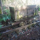 Old mining cart on tracks in Fort Lewis, Washington