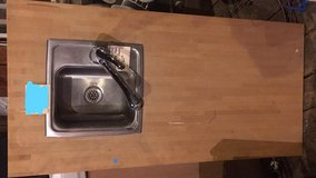 Elkay sink w/ Pfisher faucet on a butcher block counter top in Fort Wayne, Indiana