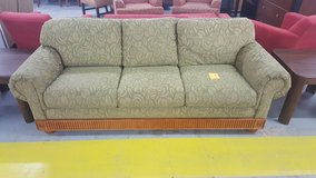 Green floral couch in Camp Lejeune, North Carolina