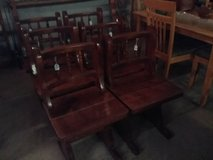 Six wood chairs in Fort Polk, Louisiana