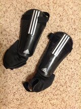Adidas shin guards and 2 pair of soccer socks, size small in Travis AFB, California