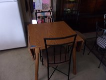 Drop Leaf Table and Three Chairs in Fort Riley, Kansas