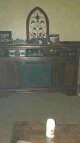 Ashley TV stand. with electric .fireplace insert in Leesville, Louisiana