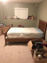 Twin size wooden bed frame in Fort Leonard Wood, Missouri