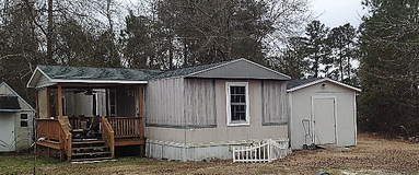 Singe wide on private lot with New central heat/air plus nice storage building on lot in Camp Lejeune, North Carolina