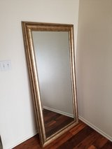 Large mirror with gold trim in Camp Pendleton, California