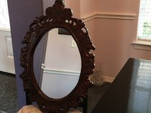 Intricate red wood mirror in Spring, Texas