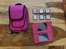 Pink Nintendo DS with games and case in Fort Bliss, Texas