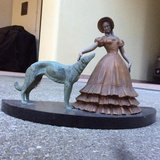 Antique figure of woman with dog in Aviano, IT