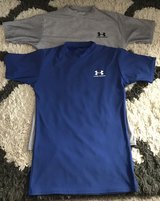 two gray and blue Under Armour crew-neck shirts in Fort Benning, Georgia