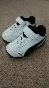 White and Black baby Puma shoes in DeKalb, Illinois