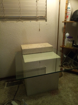 Glass top..whitw stucco table in Fort Carson, Colorado