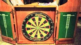 Dart Board comes in beautiful oak cabinet in Fort Leonard Wood, Missouri