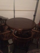 solid wood dining table plus 4 chairs in El Paso, Texas