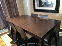 Wood dining room table with chairs in San Clemente, California